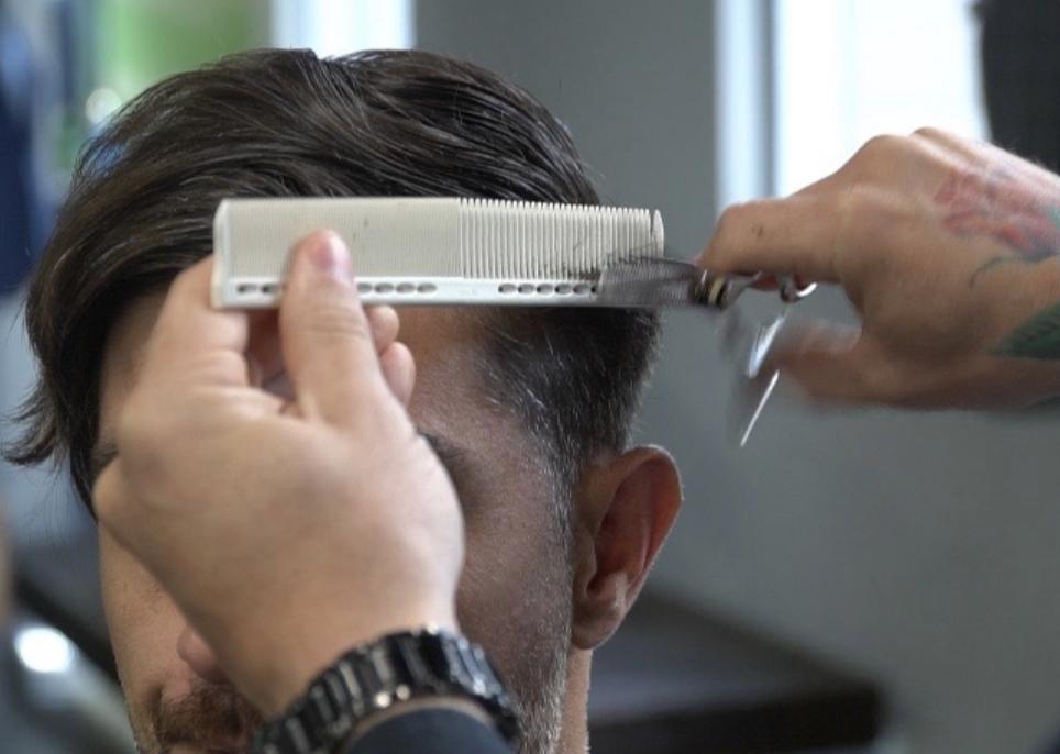 Man getting a hair cut, previously had hair botox